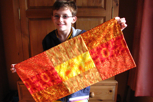 proud with quilt