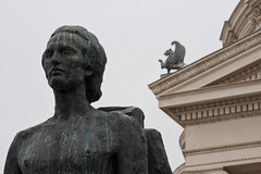 Statue of Eminescu and of creature on the Atheneum