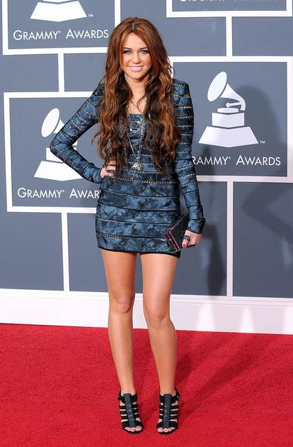 Singer Miley Cyrus arrives at the 52nd Annual GRAMMY Awards held