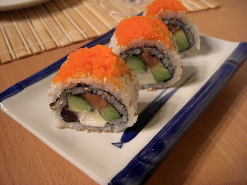 rolls with salmon, avocado, cucumber, cream cheese and tobiko