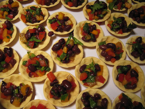 blk bean persimon canapes