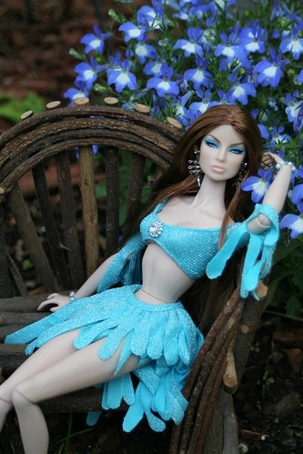 Gina Lounges Amid The Flowers