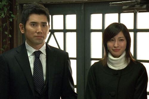 Masahiro Matoki and Ryoko Hirosue in Departures