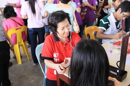 Social Concerns Ministry Worker Magdalene Huang  in action