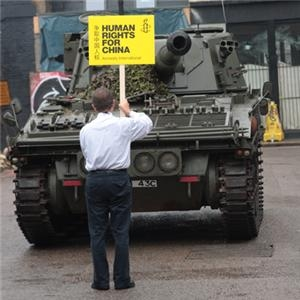man confronts tank