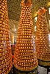 Cones of tiny Buddhas