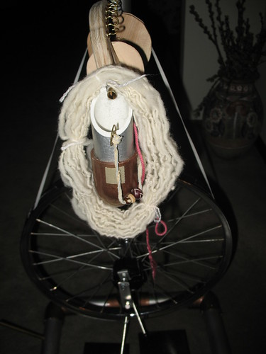 mini hank of handspun on spinning wheel