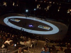 A tricycle race on an ice oval to the Benny Hill theme