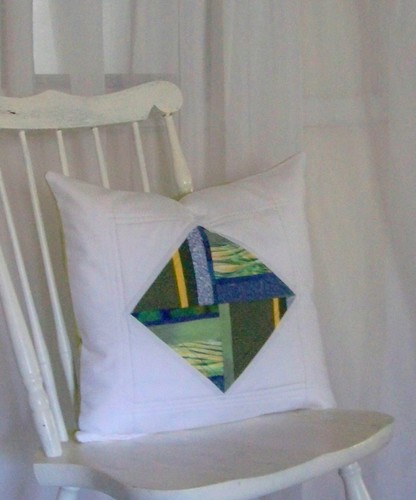 patchwork pillow: blue green diamond on white background