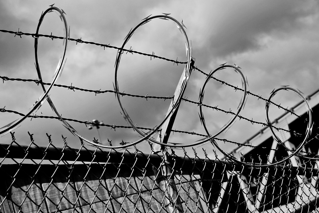 Barbed wire around Industrial Fencing Inc.
