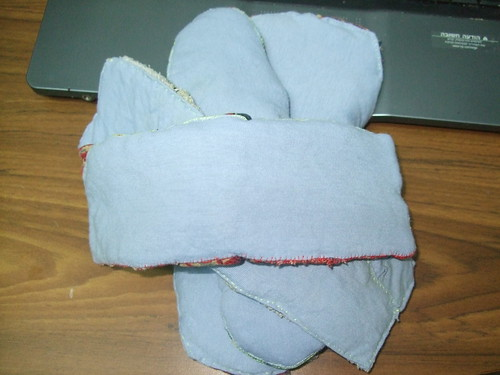 Four cloth menstrual pads, recovered in pale blue.