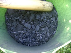 Charcoal being smashed