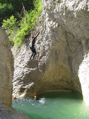 Claire jumping into a hole Canyoning