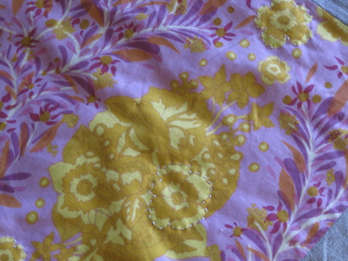 Hand quilting - around the flowers