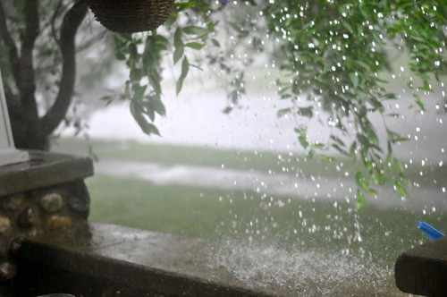 This deluge on our porch is due to a problem with the gutters