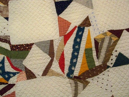 antique quilt scrappy 8-point stars on white background