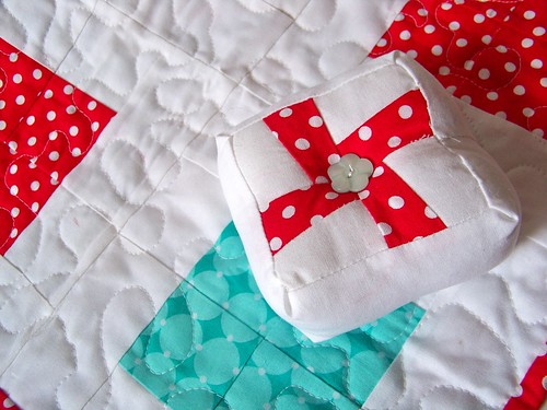 whirligig red and white modern patchwork pincushion