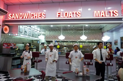 The staff of Johnny Rockets dancing