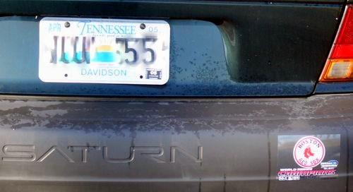 Red Sox bumper sticker on Yankee fans car