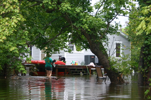 Elizabeth City - Flood - Vicky Carries Henry Back to Porch (by Ryan Somma)