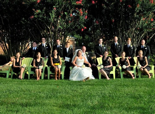 Wedding Party in adirondack chairs behind Sunset Crest Manor