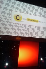 "tCn logo on big screen at ""What House?"" Awards"