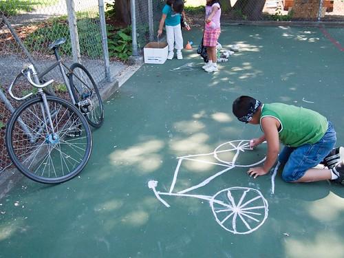 Kid drawing a fixed gear bike