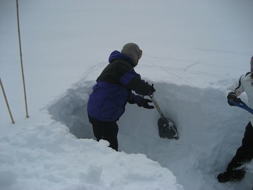 Simone works on digging a snow pit