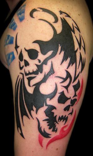 Good and Evil Skulls by Vintage Karma Tattoo Studio From Vintage Karma.