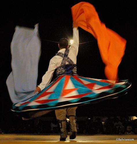 Tanoura dancer in the desert