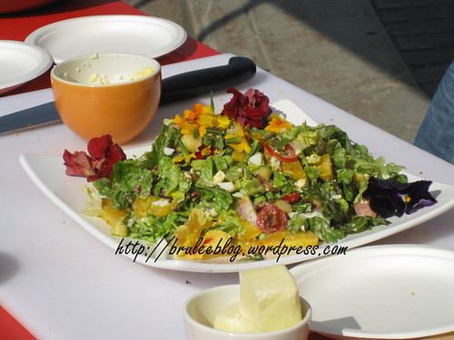the salad, complete with edible flowers
