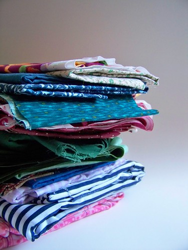 pile of folded fabric to donate