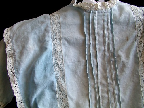 front detail of lace and pin tucks