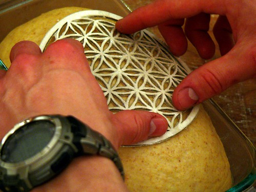 Flour stamp being applied to a bread