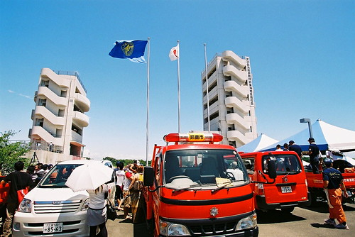 Fire fighters under a blue sky