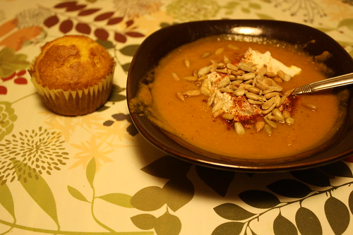 Cornbread muffin and pumpkin soup topped with sunflower seeds and greek yogurt