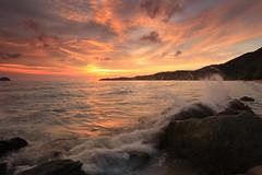 Crashing waves over sunset