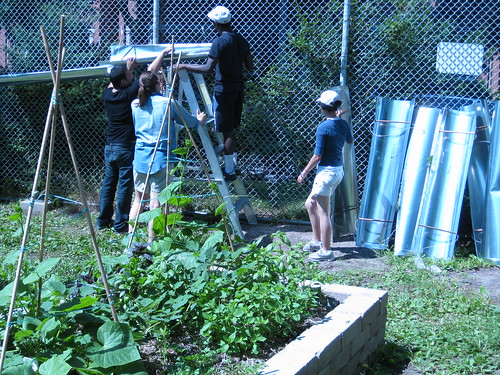 youth installing rainwater catchment for GR