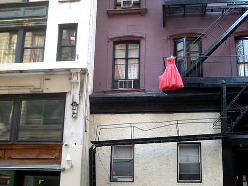 red dress hanging off balcony