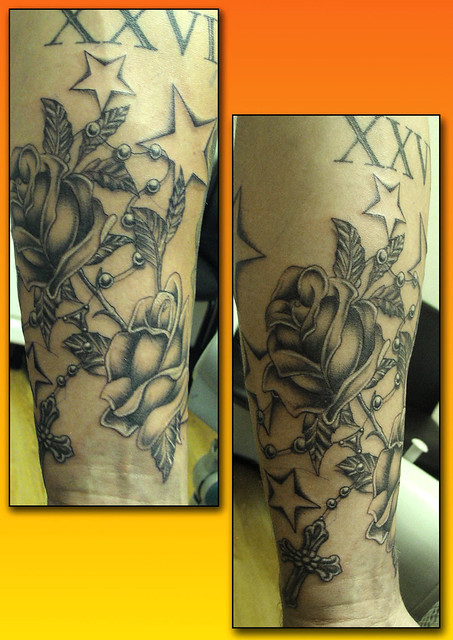 Rose rosary beads tattoo by Ray Tutty