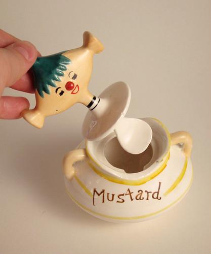 mustard jar, lid open