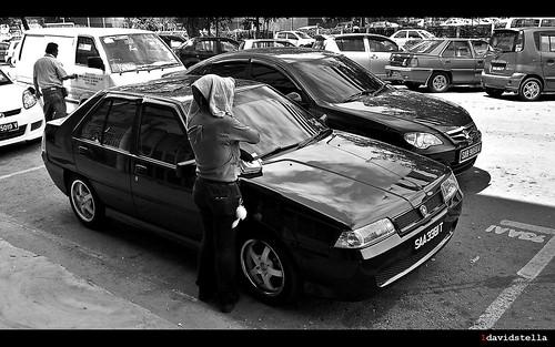 hand written parking tickets, no meters. Sabah, Kota Kinabalu.