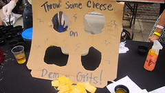 Fun with grits... throw the slice on the grits behind the cardboard and win a shot of Jim Beam!