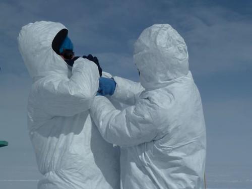 Tyvex suits require teamwork
