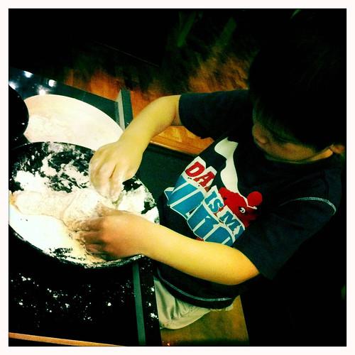 Preparing his own dinner