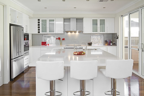 White gloss kitchen design with wooden floors