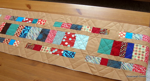 Unfinished stacked coins table runner