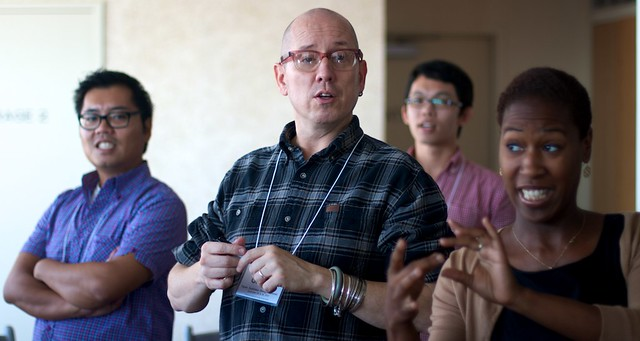 A photo of Gunner, the meeting facilitator, talking to a group of participants