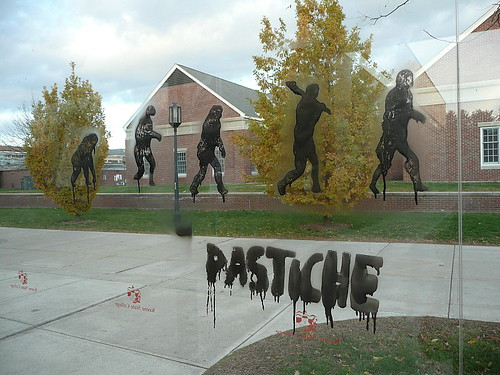 """Pastiche"" stencil on campus bus stop shelter"