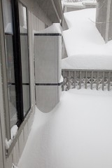 The balcony fills up with snow